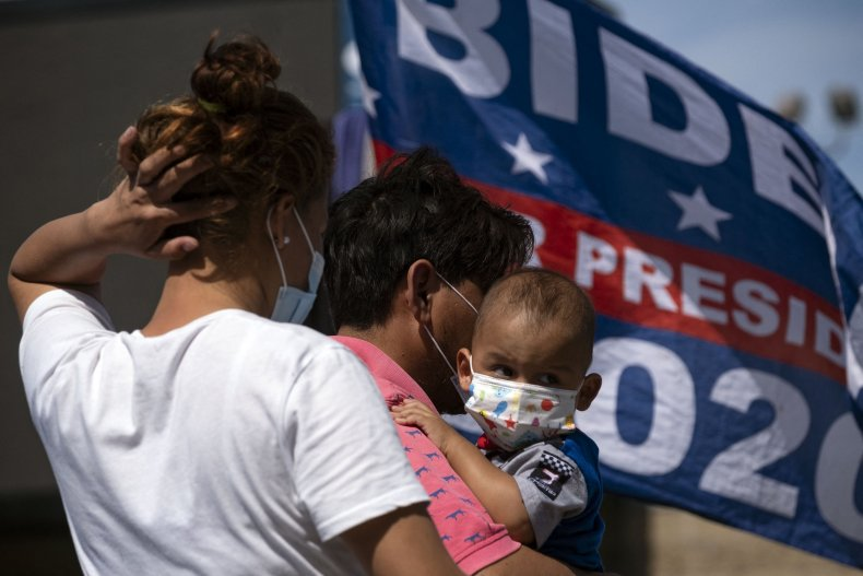 Migrants at border with Biden flag