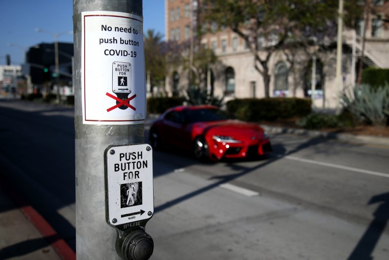 Signs are seen posted above crosswalk buttons