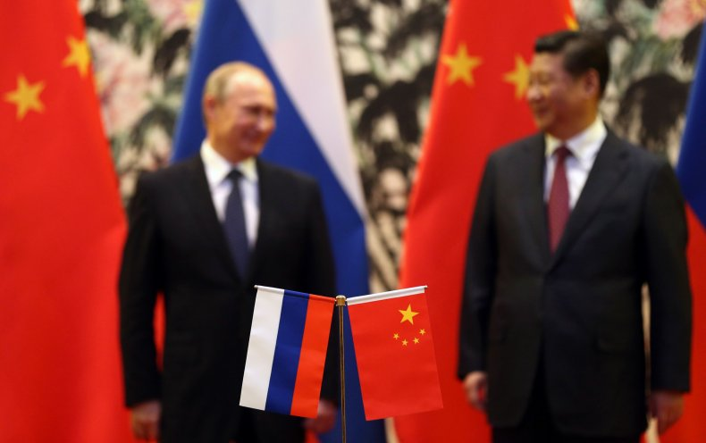 Putin and Xi with flags 2014 meeting