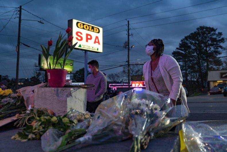 People leave flowers outside Atlanta spa