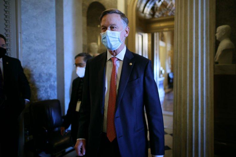 sen john hickenlooper leaves the senate chamber
