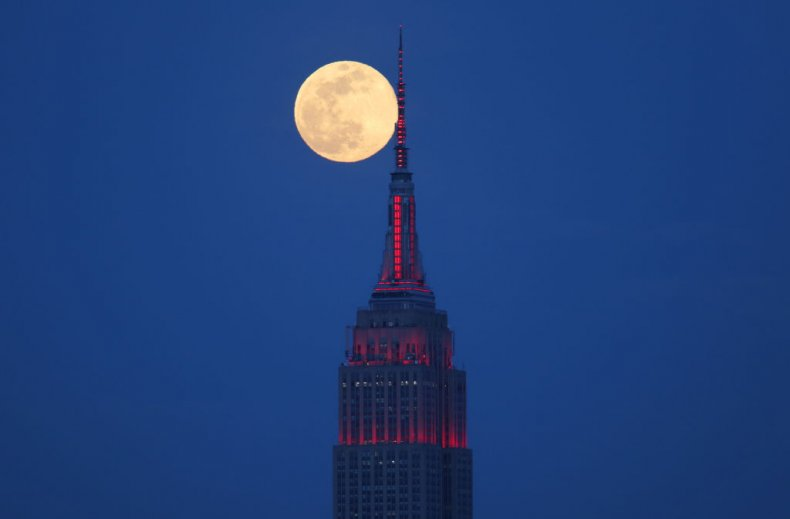 A super pink moon visible above NYC