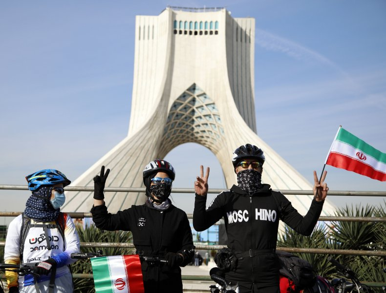 Iranians with flags in Tehran Revolution Day