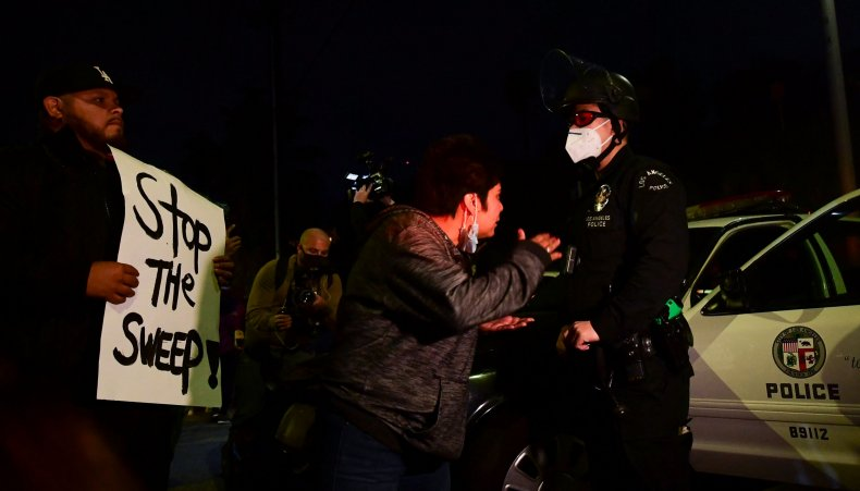 LAPD face off with homeless protesters