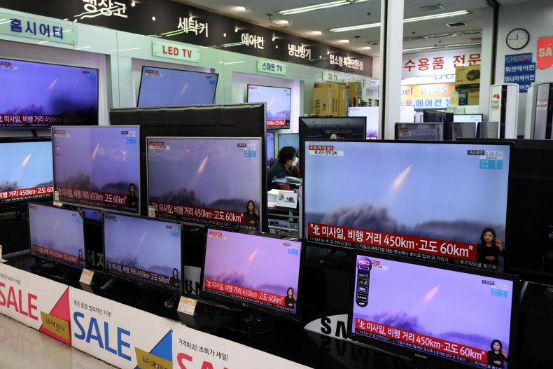TVs show north korean missile launches Seoul