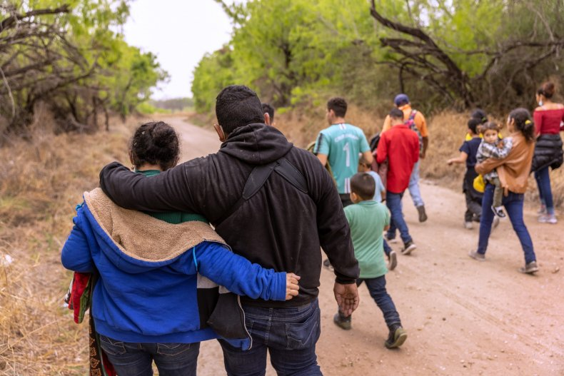 Migrants crossing border