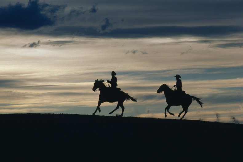Cowboys at dusk in New Mexico
