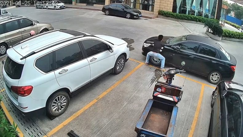 Boxed-in Driver Pushes Car Away With Hands