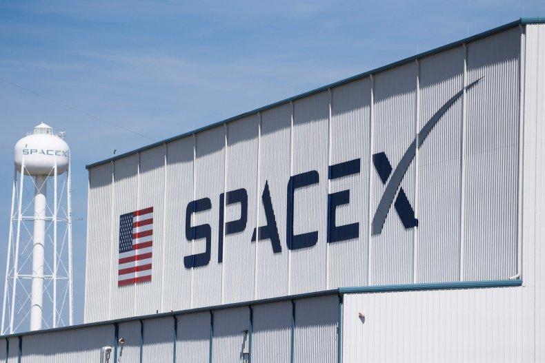 SpaceX logo on hangar