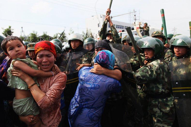Michael Waltz Chrissy Houlahan Uyghurs Uighurs China