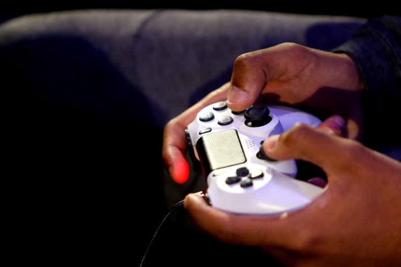 Person holding PS4 controller