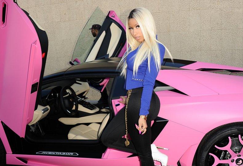 Nicki Minaj with pink Lamborghini