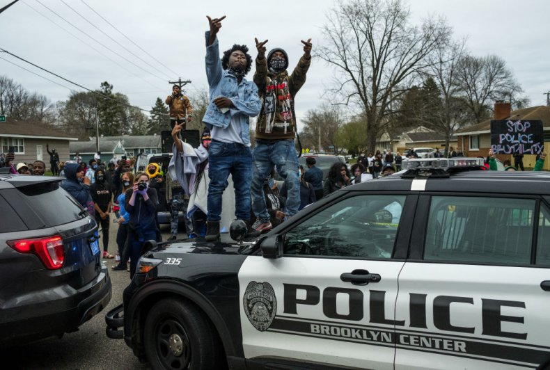 Protesters stand on police cars Brooklyn Center