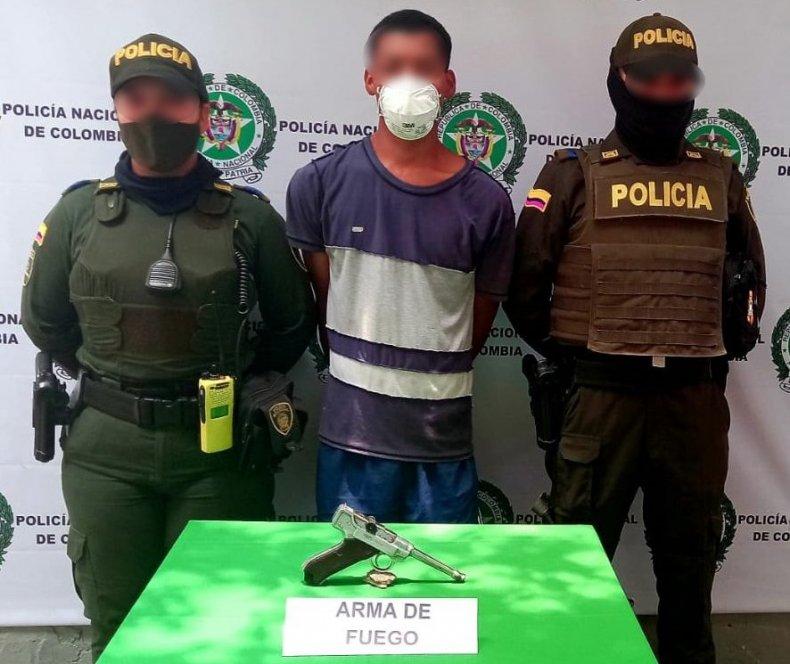 Colombia police gun
