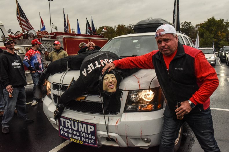 Trump supporter with an Antifa effigy