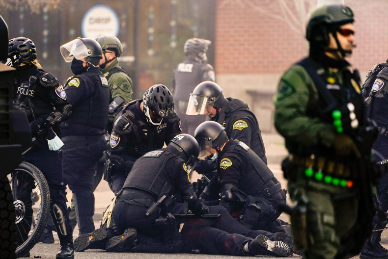 Police detain Antifa protester in Olympia, Washington