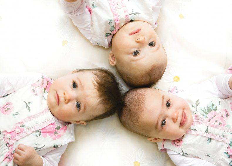 Stock image of triplets lying down