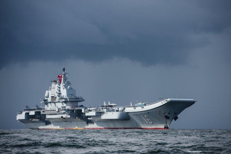 American Warship Shadows Chinese Aircraft Carrier