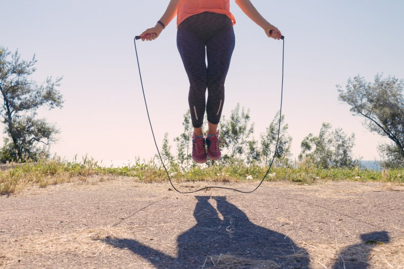 Stock image of a woman skipping