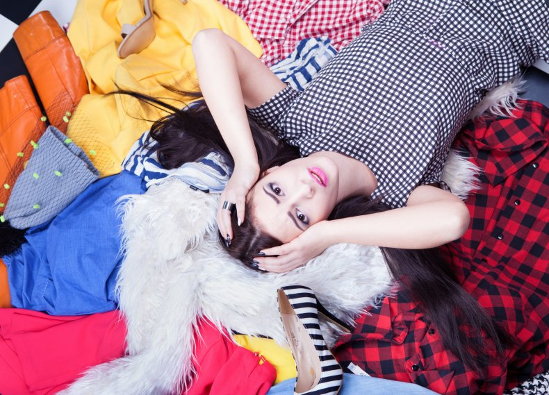 Teenager lying on a pile of clothes