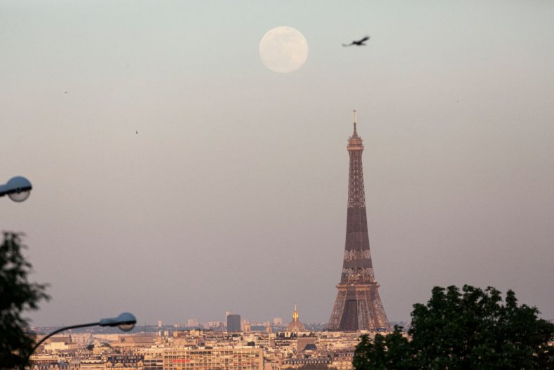 Pink moon rises above Paris' Eiffel Tower