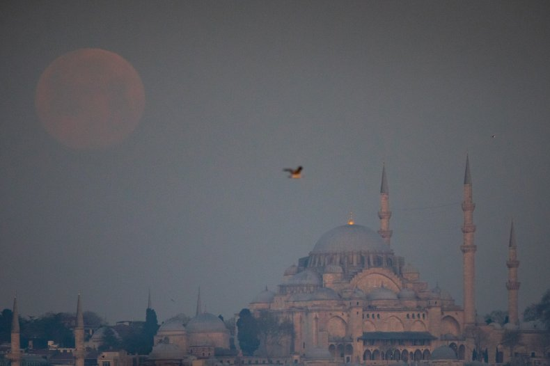 Pink moon above Suleymaniye Mosque in Istanbul