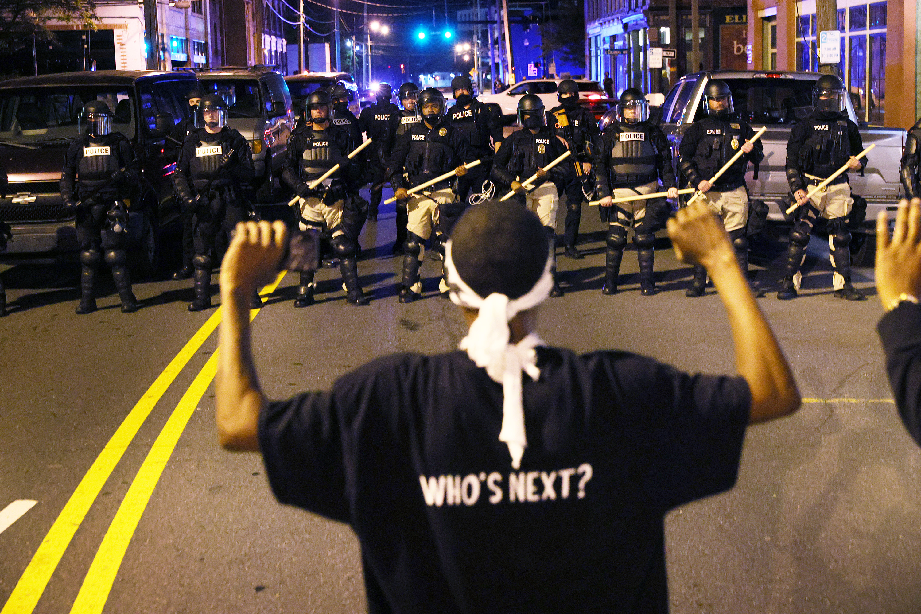 protester faces down police nc.