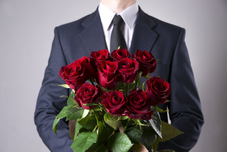 Man with bouquet of red roses