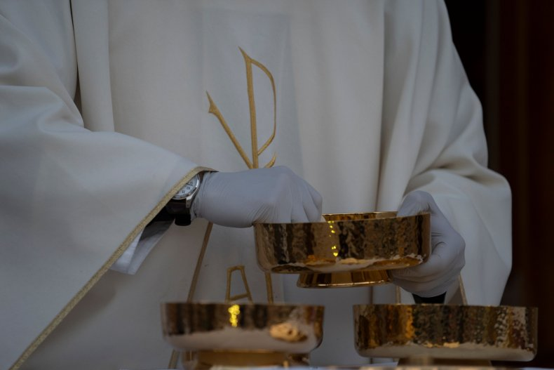 A Catholic Priest with the Eucharist