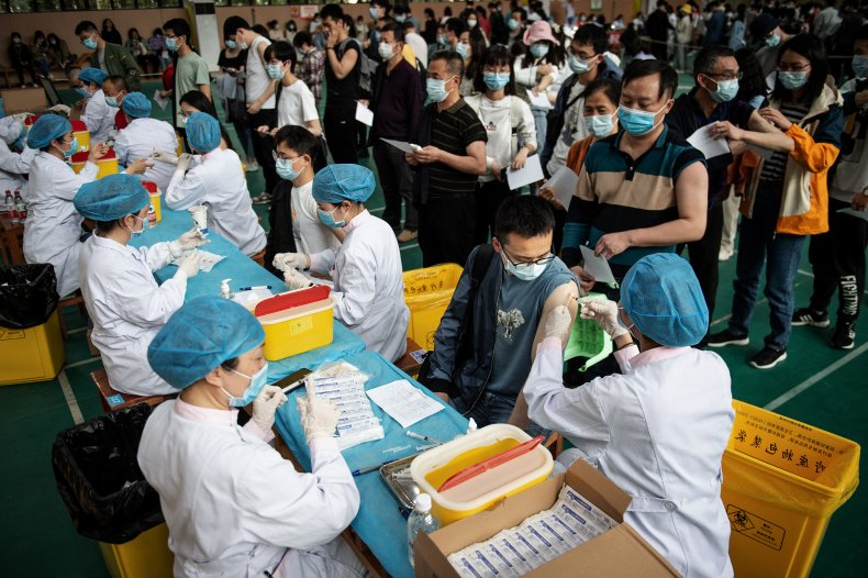 Wuhan Students Queue For COVID-19 Vaccine