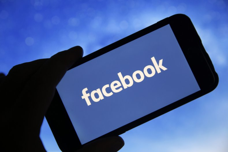 Facebook logo on phone screen