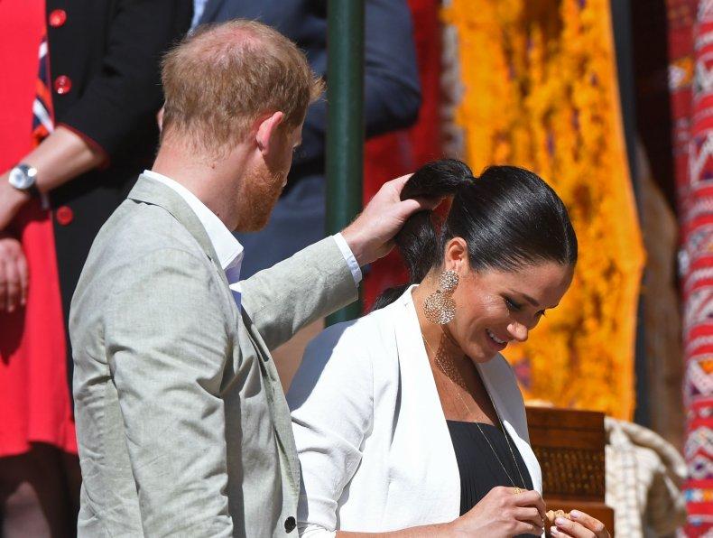 Prince Harry Fixes Meghan Markle's Hair
