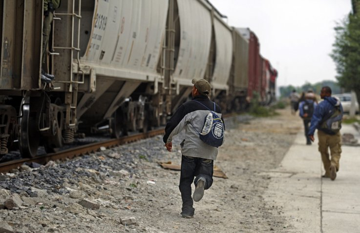 migrants running for trains
