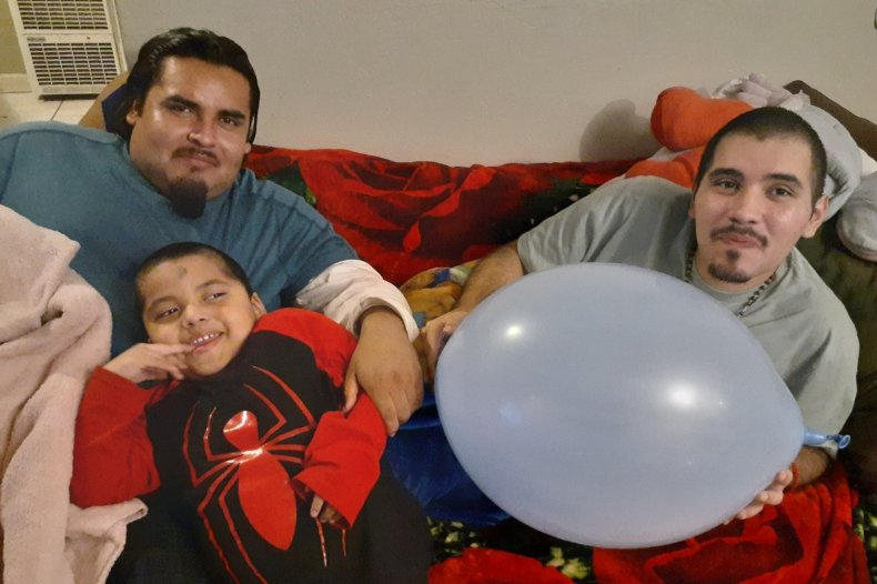 Mario Gonzalez with is son and brother