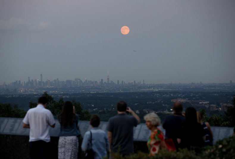 An orange-looking Moon over New York
