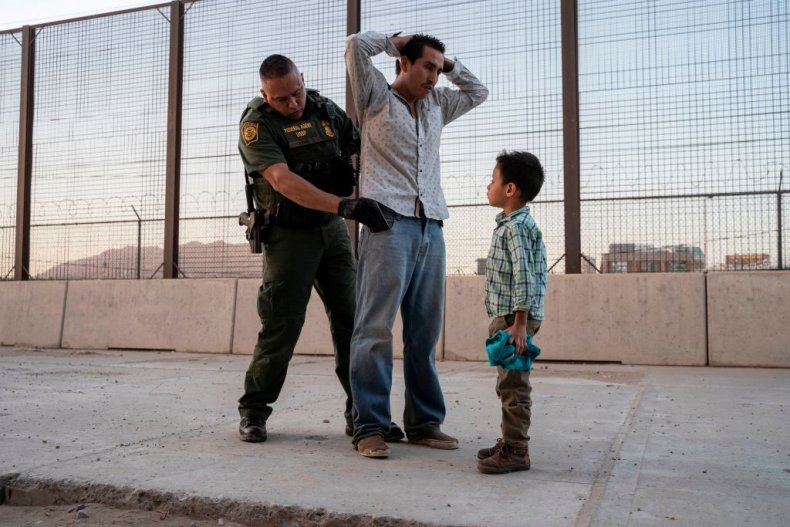 Migrant father and son