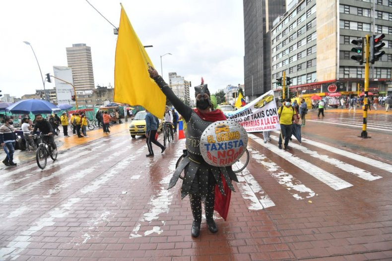 Taxi drivers protest tax reforms in Bogota