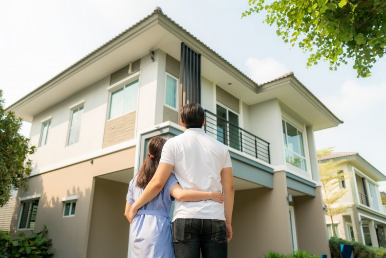 Stock image of couple and their house