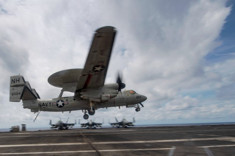 U.S. Reconnaissance Plane Lands On Carrier