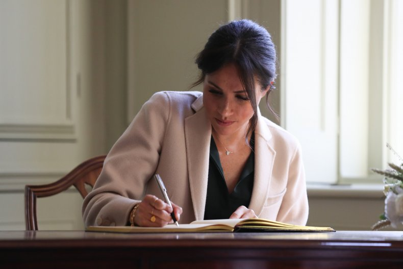 Meghan Markle Writing in Visitors Book