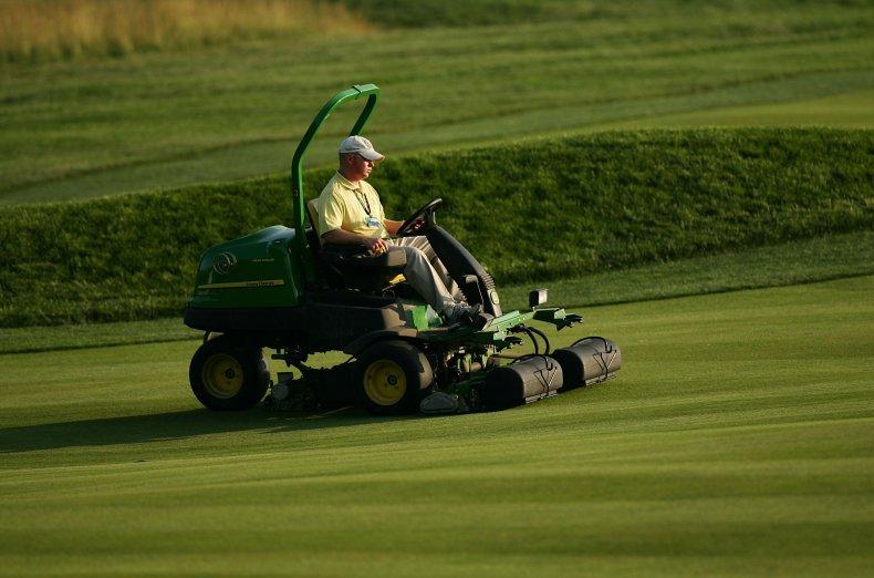 A man mows his lawn.
