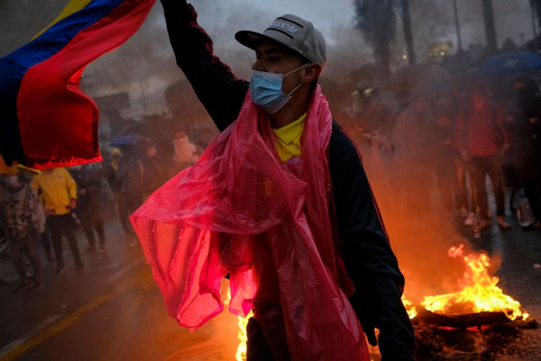 Protester wearing Colombia flag amid unrest