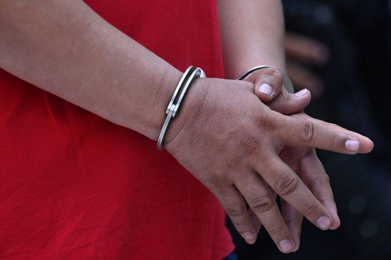 Man in handcuffs. Juan Olaya sentenced