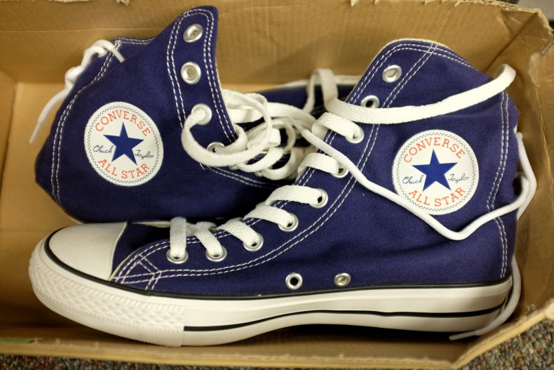 A pair of Converse sneakers in box.