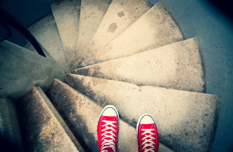 Red sneakers on spiral staircase