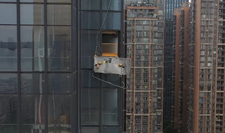 Cleaners Die As Scaffold Crashes Into Building