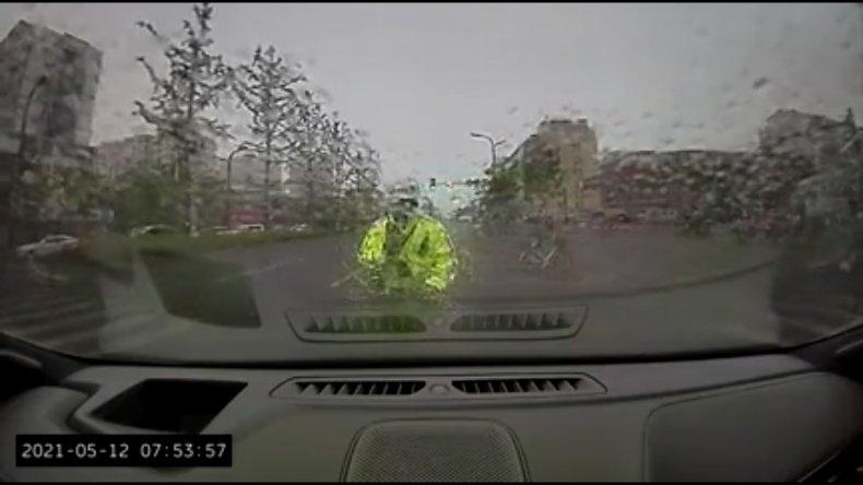 Driver Rams Traffic Cop Along Road