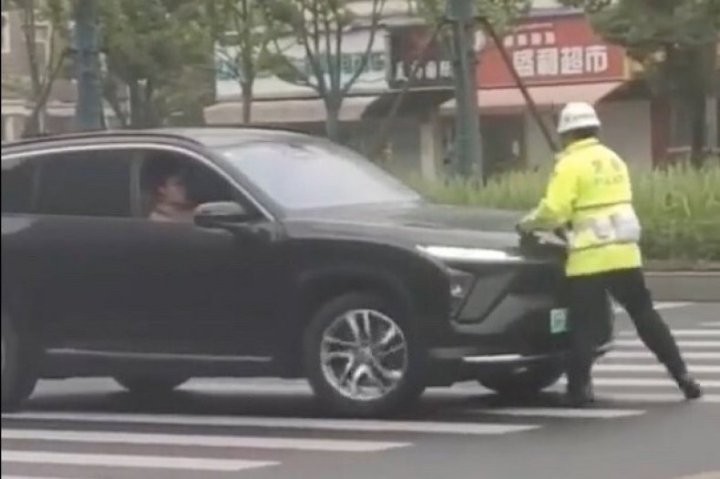 Driver Rams Traffic Officer Along Road