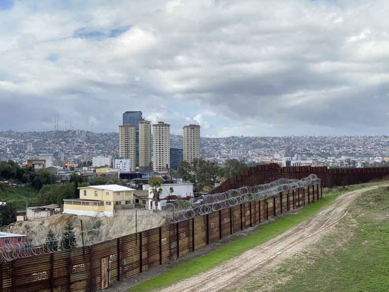 Border wall with barbed wire San Diego