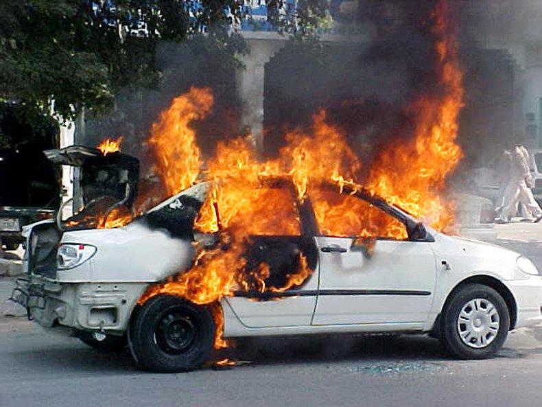 woman car vehicle explosion gasoline ignite fire